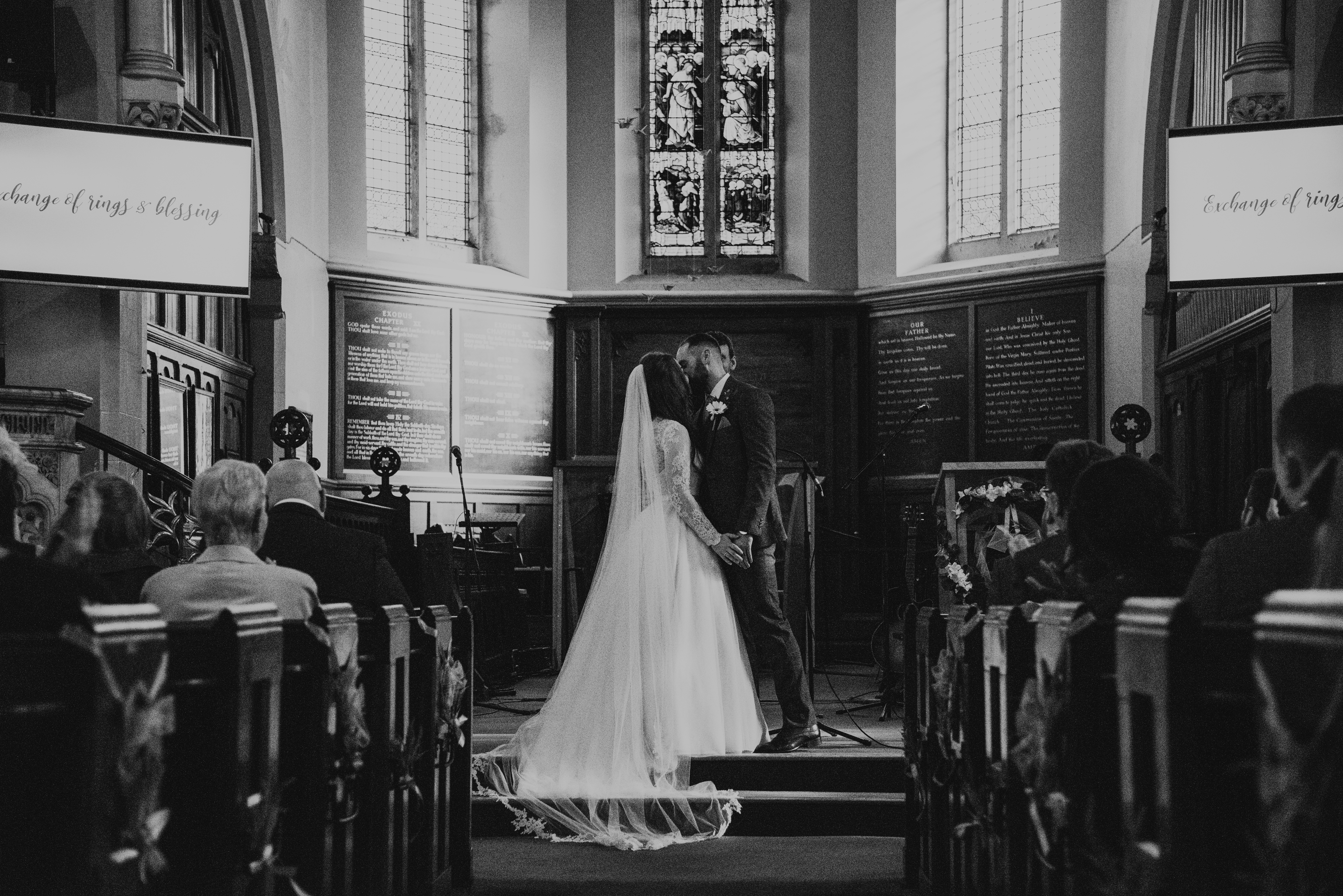 The bride and groom kisses in the church