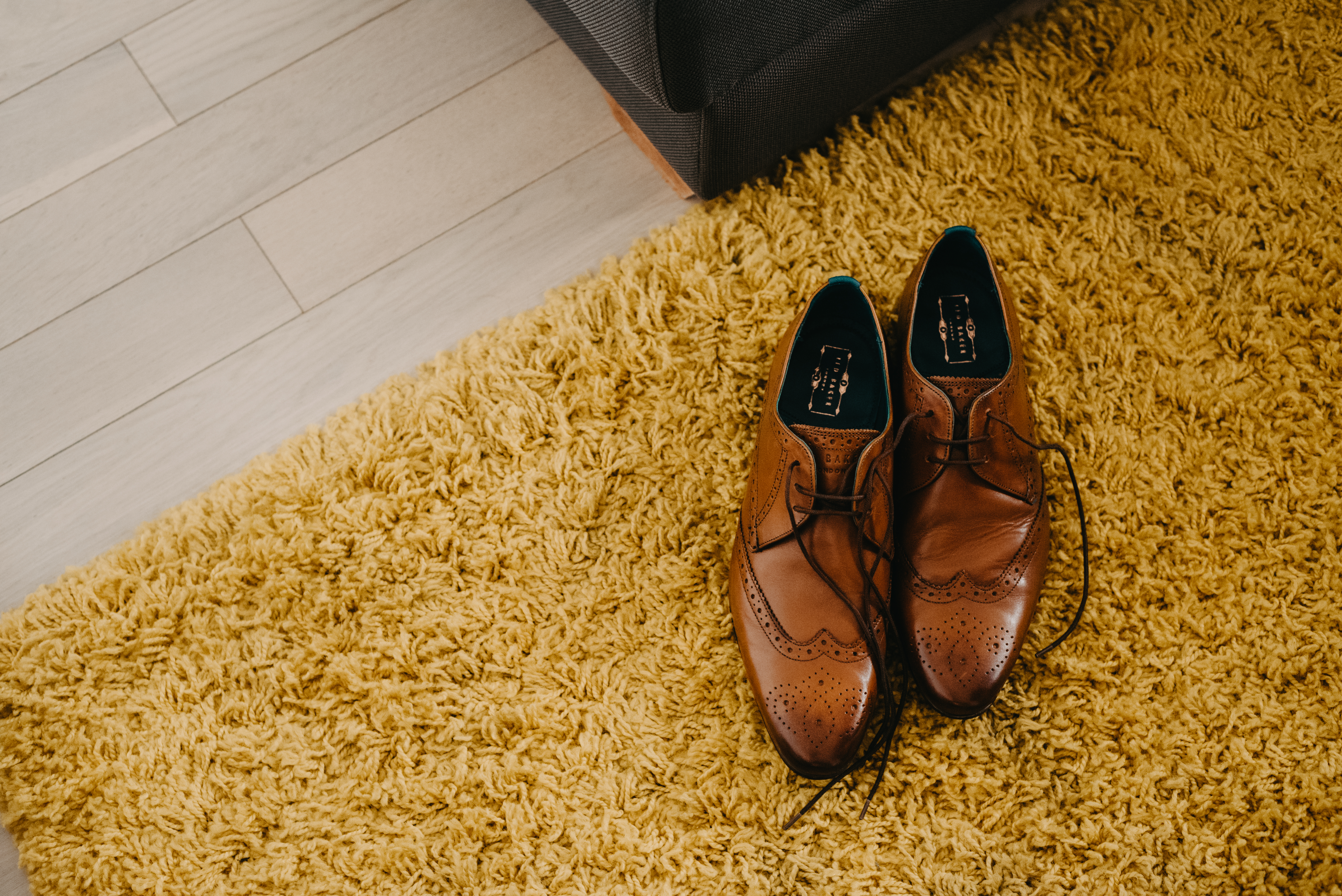 Wedding shoes on a yellow carper