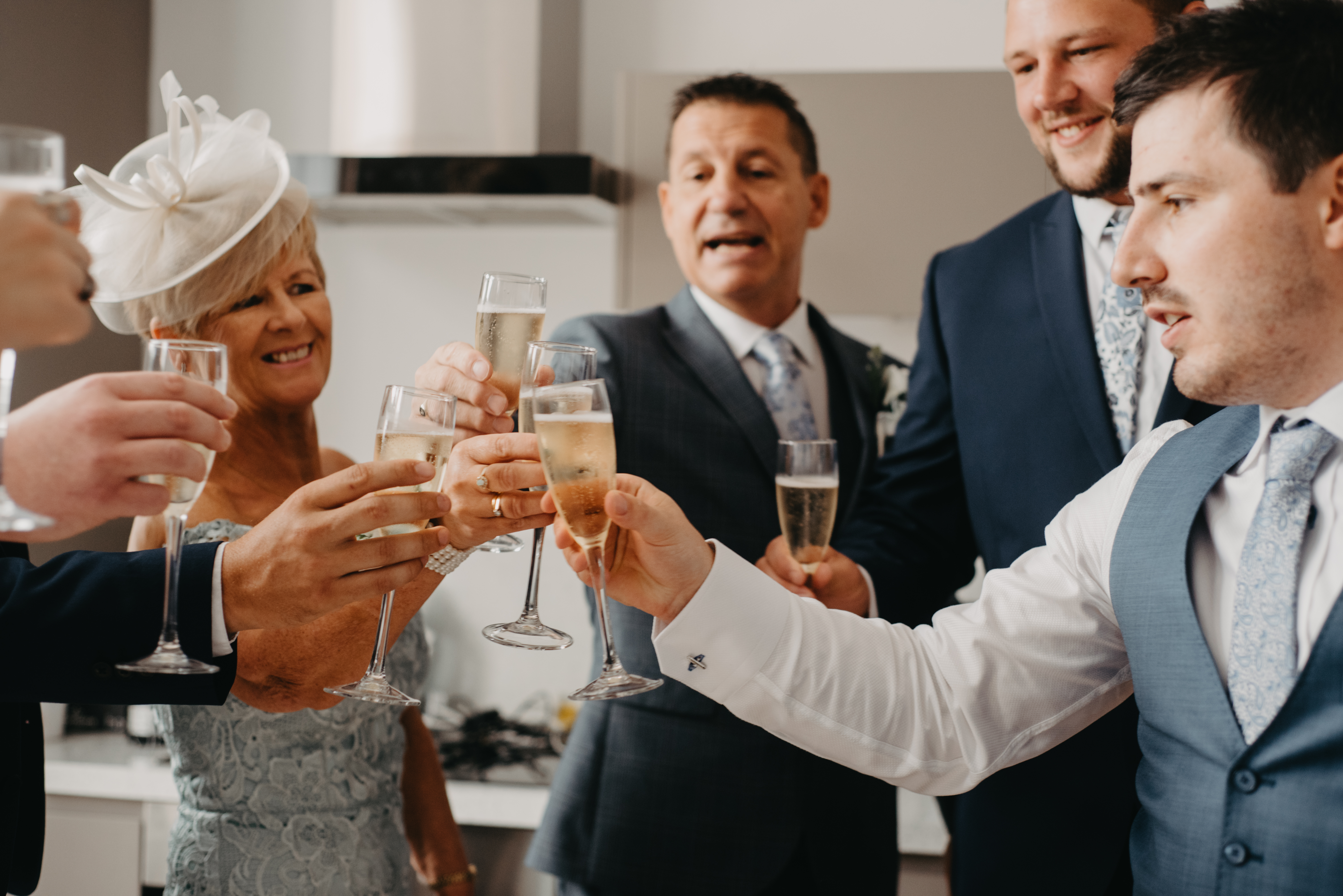 Groom and groomsmen have a champagne toast before the wedding