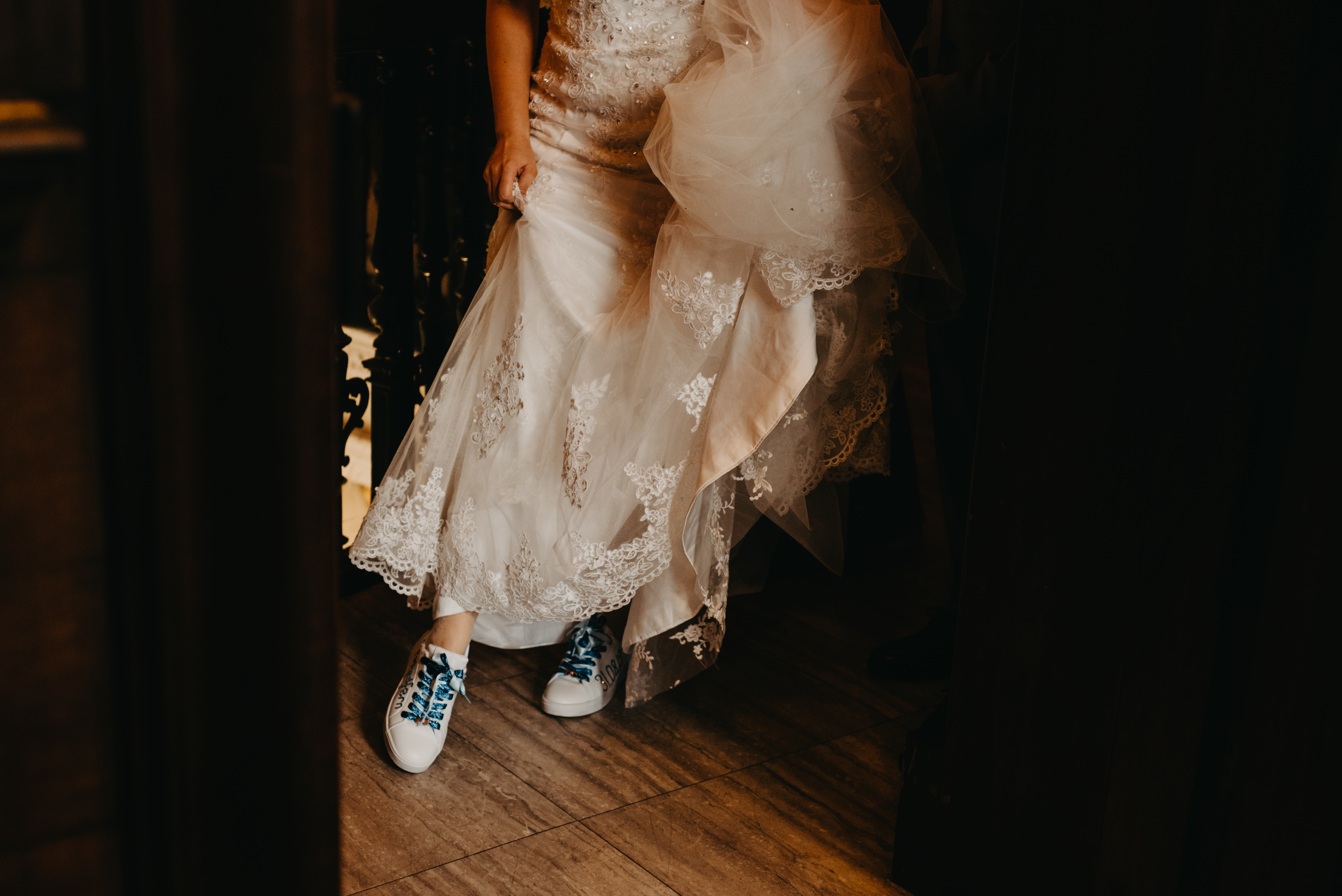The bride is wearing trainers under her wedding dress