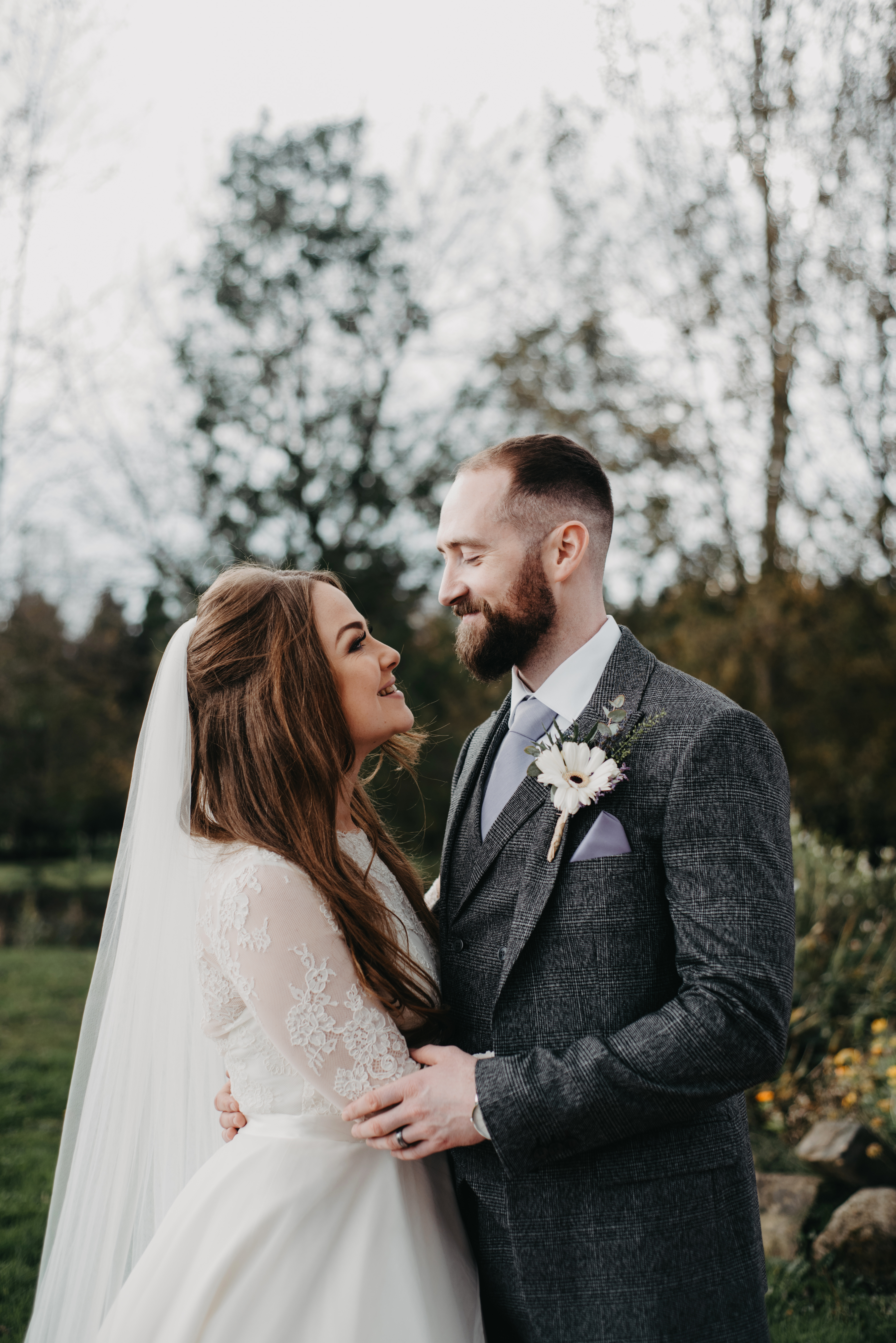 The bridal couple holding each other and smiling
