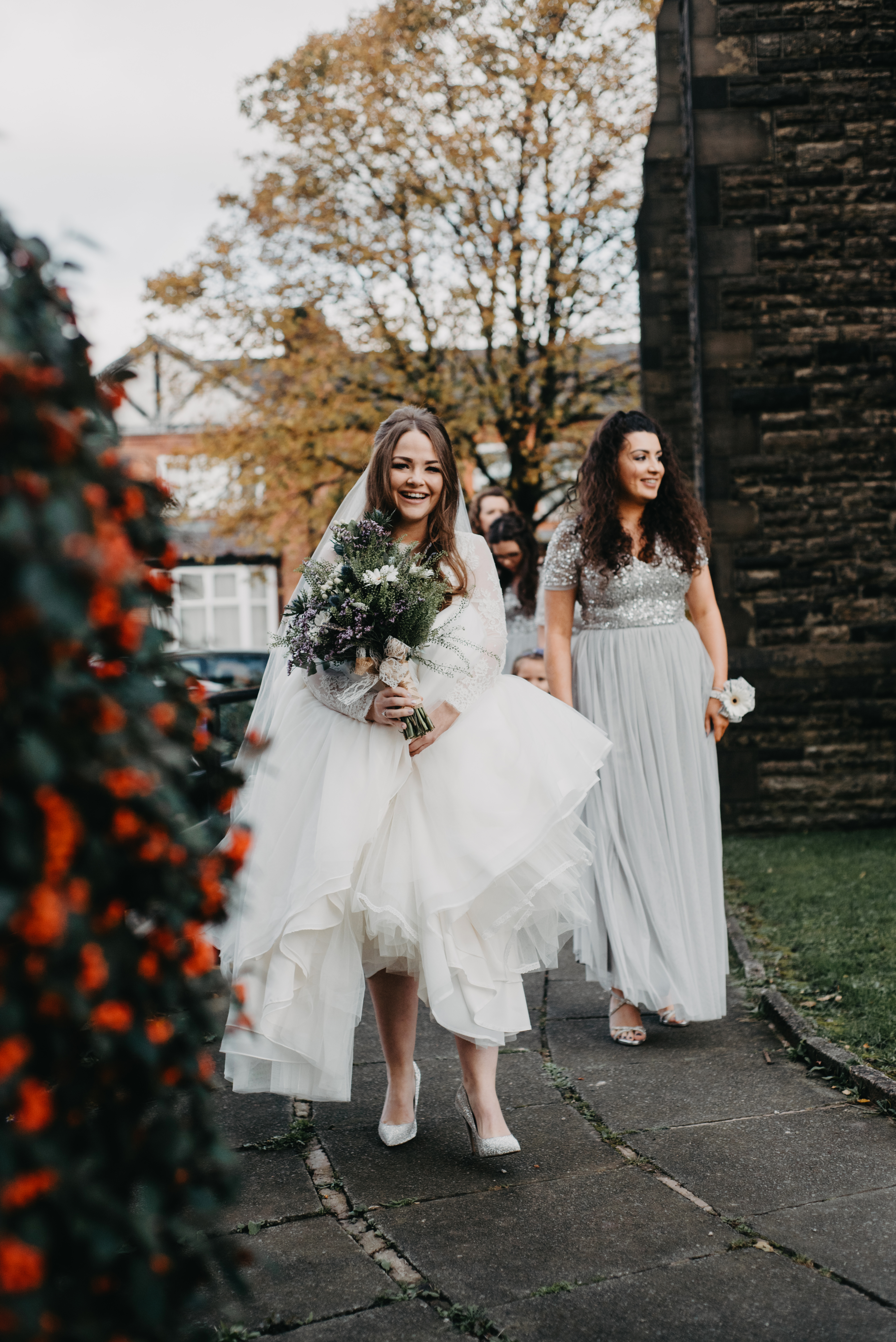 Bride walking and smiling